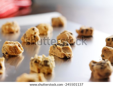 chocolate cookie dough formed on to baking tray - stock photo