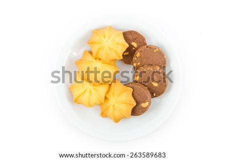 Chocolate cookies and Butter cookies on disc isolated on white background , breakfast - stock photo