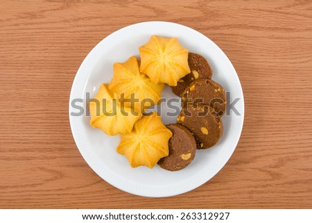 Chocolate cookies and Butter cookies on disc on wooden background , breakfast - stock photo