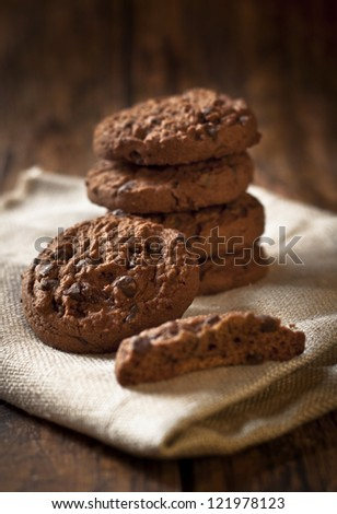 chocolate cookies over wooden background - stock photo