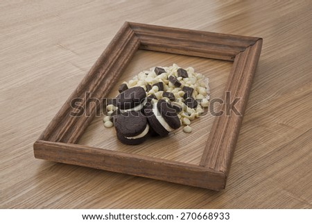 Chocolate cookies with dark and  white chocolate chips on woods background - stock photo