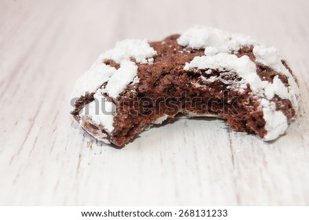 chocolate cookies with powdered sugar and cracks,  chocolate cookies with cracks, homemade cakes, delicious homemade food, delicious chocolate chip cookies. - stock photo