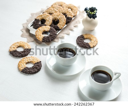 Chocolate cookies with two cups of coffee - stock photo