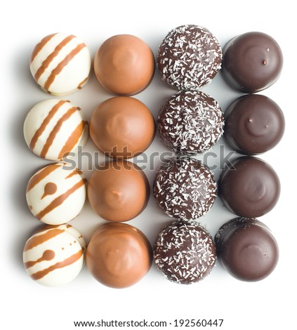 chocolate covered marshmallows on white background - stock photo