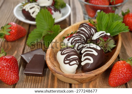 Chocolate covered strawberries on a brown background - stock photo