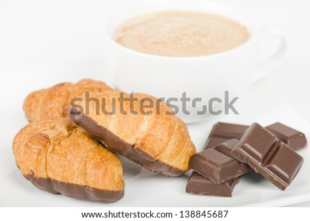 Chocolate croissants and cappuccino on a white background. - stock photo