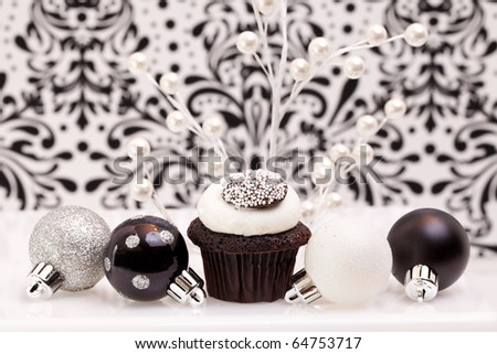 Chocolate Cupcake Against An Elegant Background With Christmas Ornaments - stock photo