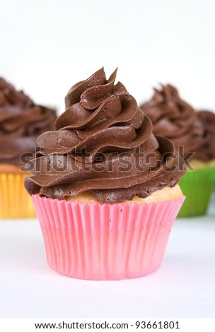 chocolate cupcake - pink wrapper - stock photo