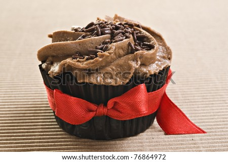 Chocolate cupcake with red bow - stock photo