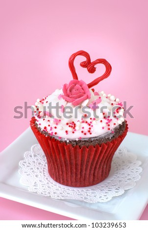 Chocolate cupcake with vanilla icing decorated with love - stock photo