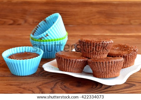 Chocolate cupcakes. Delicious homemade cupcakes. Sweet pastries. Baking molds. Chocolate cupcake in a mold  - stock photo