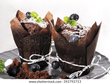 chocolate cupcakes with blueberry - stock photo