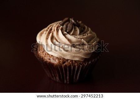 Chocolate cupcakes with coffee cream - stock photo