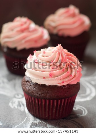 Chocolate cupcakes with swirl icing, selective  focus - stock photo