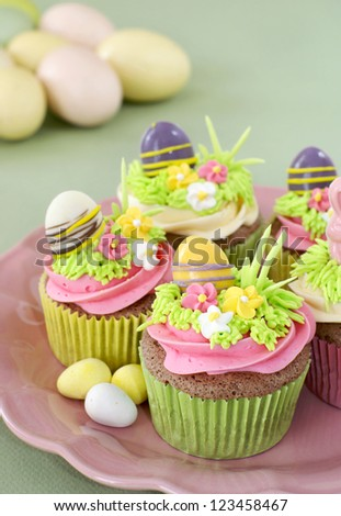 Chocolate cupcakes with vanilla frosting decorated for Easter - stock photo