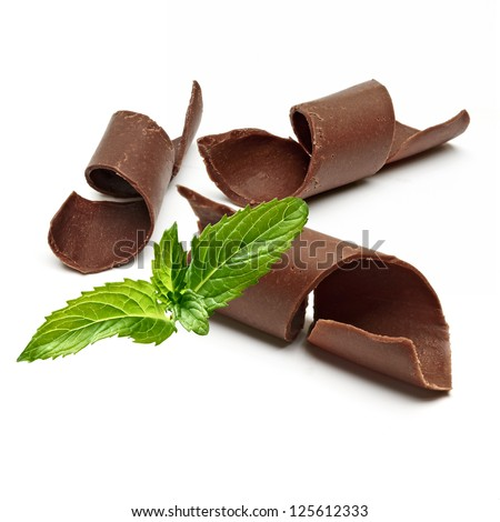 Chocolate Curls and Fresh Mint on White Background - stock photo