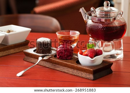 Chocolate dessert with raspberry sorbet - stock photo
