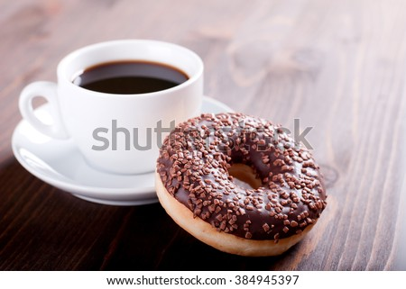 chocolate donut with coffee - stock photo