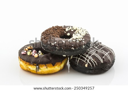 Chocolate donut with Sprinkles on white background. - stock photo