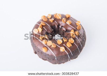 chocolate donuts on white background - stock photo