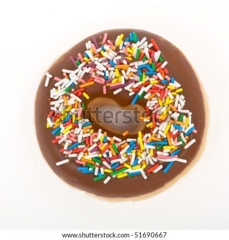 Chocolate Doughnut with vibrant multicoloured sprinkles isolated against white. - stock photo