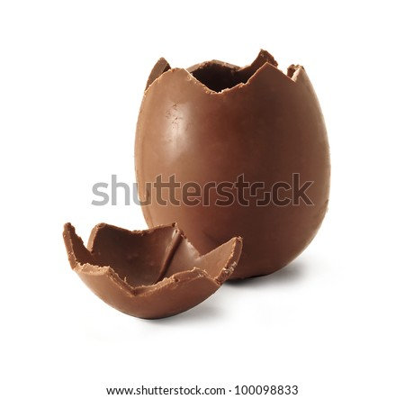Chocolate Easter egg with the top broken off - stock photo