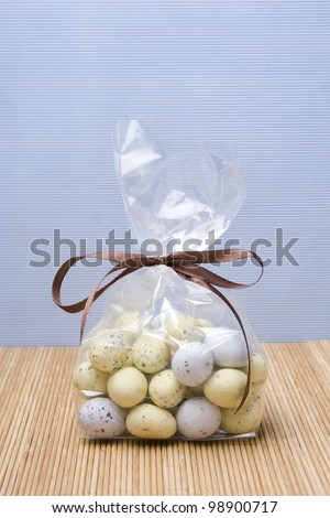 Chocolate Easter eggs are in a package tied with brown ribbon - stock photo