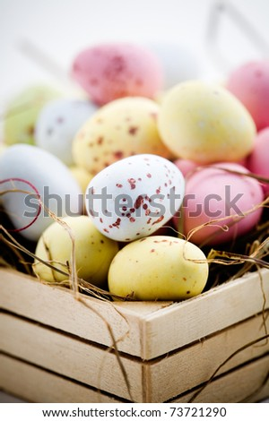 Chocolate easter eggs in little wooden box - stock photo