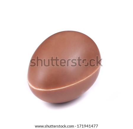 chocolate egg laying on white background - stock photo