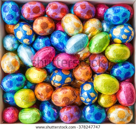 Chocolate eggs in colorful foil for easter - stock photo