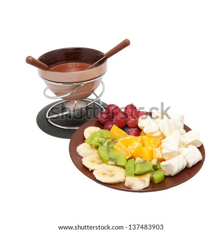 Chocolate fondue and sliced fruits on a plate. Isolated on white background. - stock photo