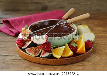 chocolate fondue with various fruits - easy and delicious dessert - stock photo