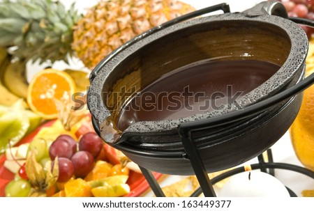 Chocolate fondue with various kind of fruit - stock photo