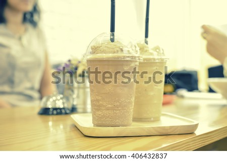 Chocolate Frappe and Frappuccino on wood plate - stock photo