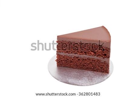 Chocolate fudge cake sliced on white background isolated - stock photo