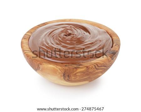 chocolate hazelnut cream in wood bowl, isolated - stock photo