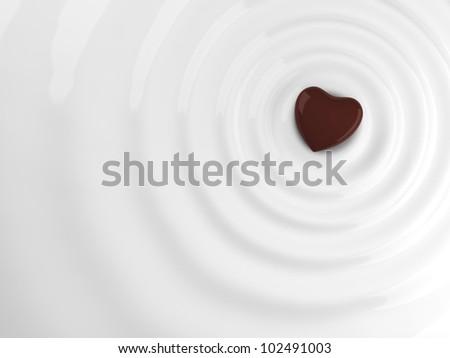 Chocolate heart in hot chocolate wave - stock photo