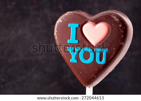 "Chocolate heart with ""I love you"" colorful inscription. - stock photo"