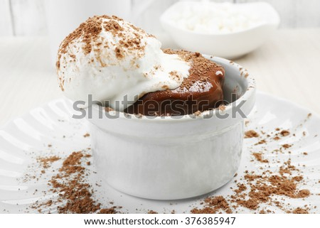 Chocolate lava cake with ice-cream on the table - stock photo