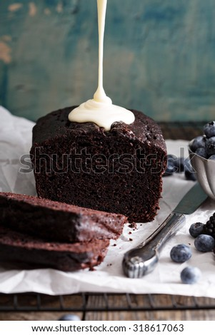 Chocolate loaf cake sliced ready to be decorated - stock photo