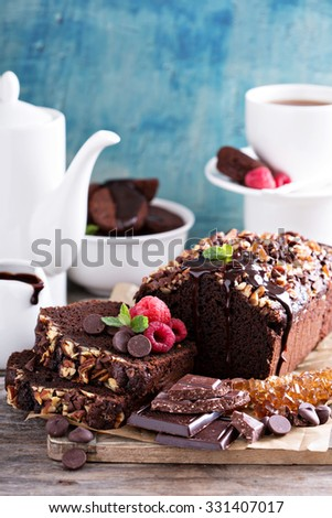 Chocolate loaf cake with pecan nuts and chocolate chips - stock photo