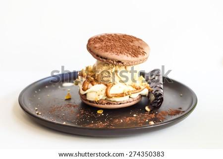 Chocolate macaron with vanilla ice cream  - stock photo