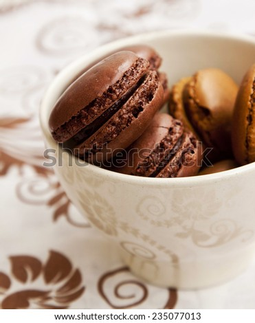Chocolate Macarons Closeup Placed in a Bowl, French Pastry Cookies - stock photo