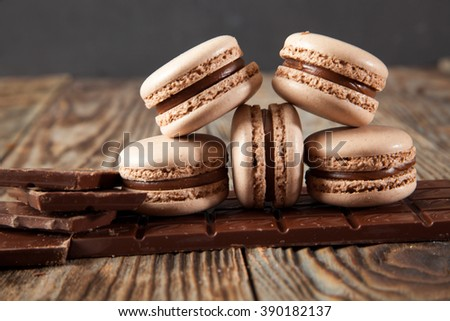 Chocolate macarons on a wooden table - stock photo