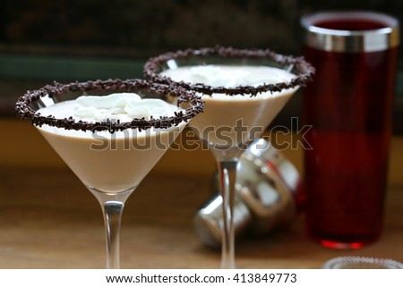 Chocolate martini garnished with chocolate powder and sprinkles on the rim and whip cream - stock photo
