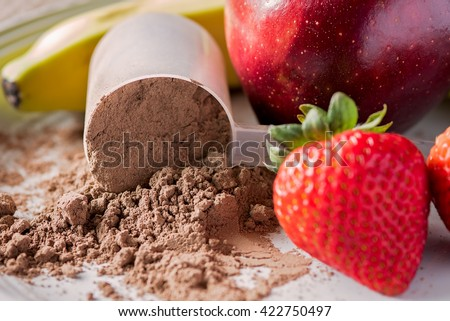 Chocolate meal replacement powder with fruit - stock photo