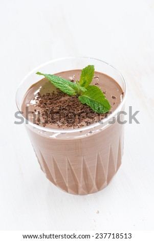 chocolate milkshake in a glass, close-up, vertical - stock photo