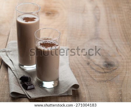Chocolate milkshake (smoothie) in glass, selective focus - stock photo