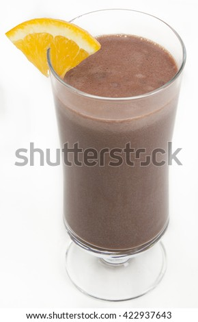 Chocolate milkshake with a slice of orange on the side against a white background - stock photo