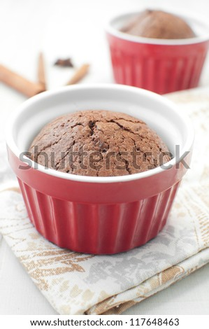 Chocolate molten cake in ramekin vertical - stock photo
